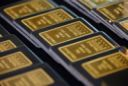 Gold makes hasty retreat as dollar holds on to gains