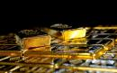 Gold drops as dollar rises on Fed's upbeat economic view
